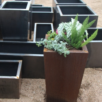 March_Newsletter_SteelPlanters